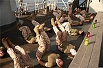 U.S. Marines with the 15th Marine Expeditionary Unit (MEU) participate in a physical training session led by Sgt. Maj. John W. Scott, the unit's sergeant major, as part of the Corporals' Course on 130308-M-YG378-125.jpg
