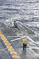 U.S. Navy Aviation Boatswain's Mate (Handling) 2nd Class David Willsey launches a Colombian navy BO-105 helicopter on the flight deck aboard the amphibious assault ship USS Peleliu (LHA 5) in the Pacific Ocean 140623-N-YW024-033.jpg