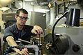 U.S. Navy Machinery Repairman Fireman Timothy Grover works on the amphibious assault ship USS Bataan (LHD 5) in the U.S. 5th Fleet area of responsibility June 28, 2014 140628-N-MW280-055.jpg