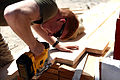 U. S. Marine Lance Cpl. Jackson Meehan with Engineer Company, Combat Logistics Regiment 2, 2nd Marine Logistics Group, builds stairs for a south west asia hut at their forward operations base during Enhanced 120910-M-KS710-025.jpg