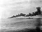 USS Bunker Hill (CV-17) burning and Randolph (CV-15) in May 1945.jpg