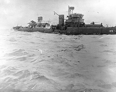 Minesweeper USS Tide after striking a mine off Utah Beach, 7 June 1944. Note her broken back, with smoke pouring from amidships. USS Tide sinking.jpg