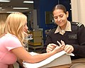 US Navy 030409-N-0000W-001 Navy Occupational Therapist Lt. Maria Barefield (right) provides hand care for a family member in the Physical Therapy Department.jpg