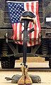 US Navy 030427-M-4066S-013 An M16-A2 service rifle, a pair of boots and a helmet stand in tribute to a fallen Marine Corps Sergeant.jpg