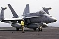 US Navy 030625-N-9319H-016 A plane director prepares to assist an F-A-18 Hornet to one of four steam driven catapults during flight operations on the flight deck aboard USS Nimitz (CVN 68).jpg