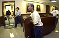 US Navy 031113-N-9693M-007 Office Mover employees wheel the Secretary of the Navy's desk.jpg