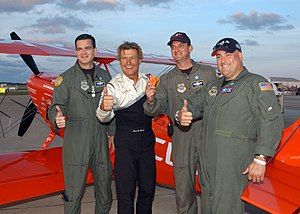 US Navy 040924-N-0620S-137 U.S. Air Force C-5 Galaxy aircrew Master Sgt. Rick Turpin, Tech. Sgt. Frank Falcone, and Maj. Star Smith, stop to take a photo with aerobatic pilot Sean Tucker.jpg