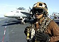 US Navy 041116-N-6817C-038 Aviation Machinists' Mate 3rd Class Durdanes Gomez, from Bronx, N.Y., stands by an F-A-18 Hornet assigned to the Fighting Vigilantes Strike Fighter Squadron One Five One (VFA-151) is directed to a cat.jpg