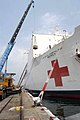 US Navy 050129-N-3372S-012 Supplies and medical materials been load onto the Military Sealift Command hospital ship USNS Mercy (T-AH 19).jpg