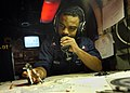 US Navy 050523-N-8604L-016 Operations Specialist 1st Class Marlon Patterson plots the transit course of the conventionally powered aircraft carrier USS Kitty Hawk (CV 63).jpg