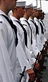 US Navy 050629-N-5345W-010 Honor Guard members stand at parade rest during a burial at sea ceremony aboard the Nimitz-class aircraft carrier USS Harry S. Truman (CVN 75).jpg