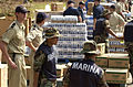 US Navy 050912-N-6436W-061 U.S. Navy Sailors, Royal Dutch Sailors, and Marines from Mexico, along with the American Red Cross, handout water and food at a Red Cross distribution point in Biloxi, Miss.jpg