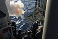 US Navy 060520-N-1512O-033 Gunner's Mates aboard the amphibious assault ship USS Bataan (LHD 5) fire the .40mm saluting battery as part of their initial qualifications, while underway.jpg
