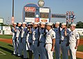 US Navy 060605-N-2908O-004 Crew members assigned to the Ohio-class submarine USS Tennessee (SSBN 734) and Navy Recruiting District Nashville raise their right hands and take the oath of enlistment at a Nashville Sounds Baseball.jpg