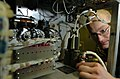 US Navy 060619-N-9723W-008 Aviation Electronics Technician 3rd Class James Harvey repairs equipment used for Tactical Air Navigation (TACAN). TACAN is used to communicate the ships position to pilots in flight.jpg