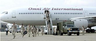 Omni Air International - An Omni Air International DC-10 disembarking naval reservists at Norfolk, Virginia