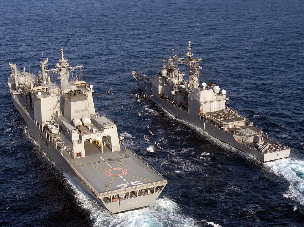 US Navy 061122-N-8036C-215 The Japanese fast combat support ship JDS Mashu (AOE 425) conducts a replenishment at sea (RAS) with the guided-missile cruiser USS Anzio (CG 68)