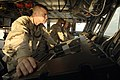 US Navy 061205-N-8148A-035 Officer of the deck, Boatswain's Mate 2nd Class Jason Burke, of Tampa, Fla., scans for surface contacts from the bridge to ensure the ship's safety at sea.jpg