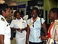 US Navy 070708-N-2888Q-005 Lt. Ladonna Gordon (left), and Lt. Kathryn S. Wijnaldum, Recruiters in the Detroit area, talk with two high-school seniors at the 98th National Association for the Advancement of Colored People (NAACP.jpg