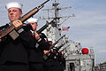 US Navy 071027-N-7352A-010 The rifle guard aboard guided-missile destroyer USS Russell (DDG 59) stands at attention during a burial at sea ceremony.jpg
