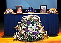 US Navy 071029-N-3005P-008 Photos, flags and flowers adorn the table display at the memorial service at the Installation Services Support Center for Master-at-Arms Seaman Genesia Gresham and Master-at-Arms Seaman Apprentice Ana.jpg