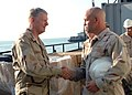 US Navy 071029-N-7682E-128 Chief of Naval Operations (CNO) Adm. Gary Roughead shakes hands with Lt. Cmdr. Matthew Hall after receiving a tour of Khawr Al Amaya Oil Terminal (KAAOT).jpg