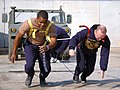 US Navy 080112-N-7367K-012 Utilitiesman Constructionman Michael Holman, left, and Steelworker 2nd Class Michael Bales, both assigned to Naval Mobile Construction Battalion (NMCB) 15, work together to pull a Humvee.jpg