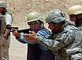 US Navy 080716-N-1765B-028 Cmdr. Joseph Limjuco, right, instructs a Ramadi judge in firearms training.jpg