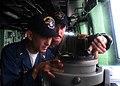 US Navy 080720-N-6764G-290 Chief Warrant Officer 2 John Rivera and Lt. Terry Menteer check bearings aboard the amphibious transport dock ship USS San Antonio (LPD 17).jpg