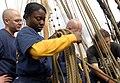 US Navy 080828-N-1531D-065 Information Systems Technician 1st Class Deborah Frazier coils a mast line.jpg