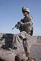 US Navy 081012-M-1341G-042 Hospital Corpsman Ryan Magsayo, assigned to Golf Company, 2nd Battalion, 7th Marine Regiment, provides security during a patrol through the district of Bala Baluk in the Farah Province of Afghanistan.jpg