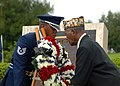US Navy 081111-N-8816D-092 World War II veteran Harry J. Thomas, right, a Navy Petty Officer 3rd Class in 1945, and a member of the Kadena Air Base Honor Guard place a wreath.jpg