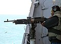 US Navy 081216-N-6764G-170 Gunner's Mate 1st Class Montrell Dorsey fires an M240B automatic weapon during a live-fire training exercise aboard the amphibious transport dock ship USS San Antonio (LPD 17).jpg
