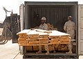 US Navy 090506-N-9410R-046 Seabees assigned to Naval Mobile Construction Battalion (NMCB) 5 deployed to Afghanistan supporting NATO International Security Assistance Force offload a delivery of wood.jpg