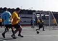 US Navy 090612-N-4879G-615 A Sailor assigned to the guided-missile frigate USS Ford (FFG 54) kicks the ball at the Peruvian Submarine Forces goal as one of their sailors drops down to block it during a multi-national soccer tou.jpg