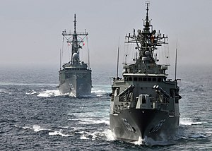 US Navy 090717-N-4236E-473 The Royal Australian Navy Adelaide-class guided missile frigate HMAS Sydney (FFG 03) and the Anzac-class frigate HMAS Ballarat (FFG 155) perform formation maneuvering with the guided missile destroyer.jpg