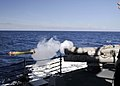US Navy 090805-N-2638R-001 A MK-46 recoverable exercise torpedo (REXTORP) is ejected from a torpedo tube aboard the Arleigh Burke-class guided-missile destroyer USS Mustin (DDG 89) during a REXTORP exercise.jpg