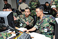 US Navy 090817-N-5086M-008 U.S. Navy Lt. Cmdr. Jason Nunez, left, and Republic of Korea Navy Lt. Cmdr. Kim Dae-ik work as part of the Naval Operations Coordination Team during Ulchi Freedom Guardian 2009.jpg