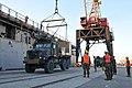 US Navy 100115-N-1831S-073 Marines load supplies aboard USS Bataan (LHD 5).jpg