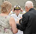 US Navy 100430-N-8848T-776 nsign Jessica Alexander, from Killeen, Texas, adjusts her cover in front of family members.jpg