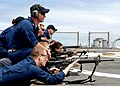 US Navy 100512-N-1559J-083 Chief Gunner's Mate Matthew Rayburn supervises the firing line during a weapons qualification.jpg