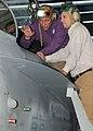 US Navy 100522-N-7908T-032 Cmdr. William Pennington describes the cockpit of an F-A-18C Hornet to Under Secretary of Defense (Comptroller) Robert F. Hale.jpg