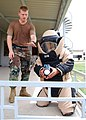 US Navy 100609-N-8539M-096 A U.S. and a Cambodian service member approach a simulated improvised explosive device.jpg