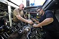 US Navy 100831-N-8546L-100 Chief Engineman Edward D. Young, from Gadsden, Ala., an instructor assigned to Maritime Civil Affairs and Security Training (MCAST), teaches a Costa Rican coast guardsman how to time an engine.jpg