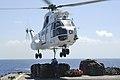 US Navy 100925-N-8335D-545 Damage Controlman Fireman Jasmine Bly and Seaman Arthur Hubbard hook a pole pendant to a Military Sealift Command SA-330.jpg