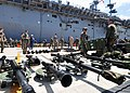 US Navy 110412-N-5538K-380 Marines assigned to the 31st Marine Expeditionary Unit organize equipment after debarking the forward-deployed amphibiou.jpg