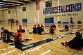 US Navy 110510-N-CD297-052 Members of the Navy-Coast Guard Warrior Games sitting volleyball team enhance their skills and develop team strategies d.jpg