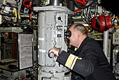 US Navy 111010-N-ZZ999-005 Rear Adm. Bernt Grimstvedt, chief of the Royal Norwegian Navy, looks through the periscope of the Los Angeles-class subm