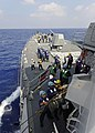 US Navy 111025-N-VH839-012 Sailors assigned to the guided-missile destroyer USS Wayne E. Meyer (DDG 108) man replenishment stations during a replen.jpg