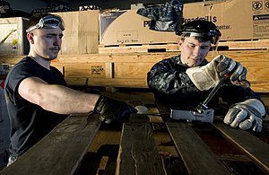 US Navy 111220-N-VO377-184 Sailors assigned to the Nimitz-class aircraft carrier USS Abraham Lincoln (CVN 72) bind empty pallets together during an.jpg